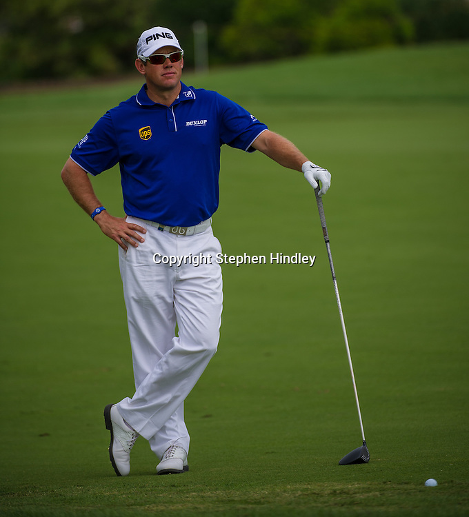 Lee Westwood of England waits for the green to clear before his second stoke on hole 2 during the final round of the DP World Tour Championship held at the Jumeirah Golf Estates in Dubai, United Arab Emirates, on Sunday, November 17, 2013.  Photo by: Stephen Hindley/SPORTDXB