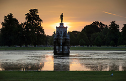 © Licensed to London News Pictures. 24/06/2020. London, UK. The sun rises behind the Diana Fountain in Bushy Park, south west London. High temperatures and sunshine are expected in most of the UK over the next few days. Photo credit: Peter Macdiarmid/LNP