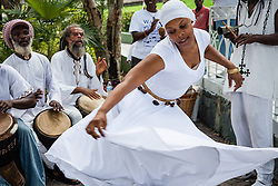 "Marie Paul of Ife Ni Jo AFrican dance & drum group dances to drumming music popular in the day of the day.  7th Annual Dollar Fo' Dollar Culture & History Tour & MIni Coaling Exhibit.  A remebrance of the 1892 Coal Workers Strike on St. Thomas ""livicated"" to Ras Jahstarr Koniyah.  Held annually in September, the tour celebrates the successful protest of 19th centry coal laborers in the streets of downtown Charlotte Amalie for better pay.  Mary Ann Christopher plays the role of Queen Coziah who led the successful revolt.  © Aisha-Zakiya Boyd"