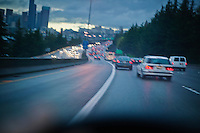 First person / drivers perspective while driving on a freeway (Interstate 5) into downtown Seattle (North bound)on a rainy cloudy day.