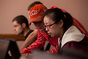 International student Xiumin Jin of China (Right) complete her tax forms with the assistance of student volunteer Lindsey Marginian at a income tax assesment program offered by the College of Business at Ohio University.