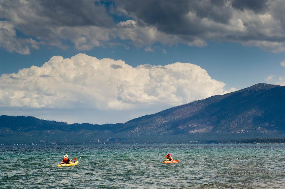 Pair of adult people kayak on water of Lake Tahoe, from Kiva Beach, California