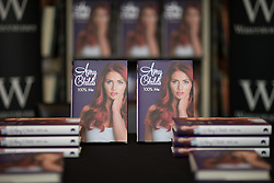 © Licensed to London News Pictures . 10/10/2015 . Manchester , UK . Amy Childs ' book , 100% Me , at Waterstones in the Trafford Centre in Manchester at a book signing by the Amy Childs . Photo credit : Joel Goodman/LNP
