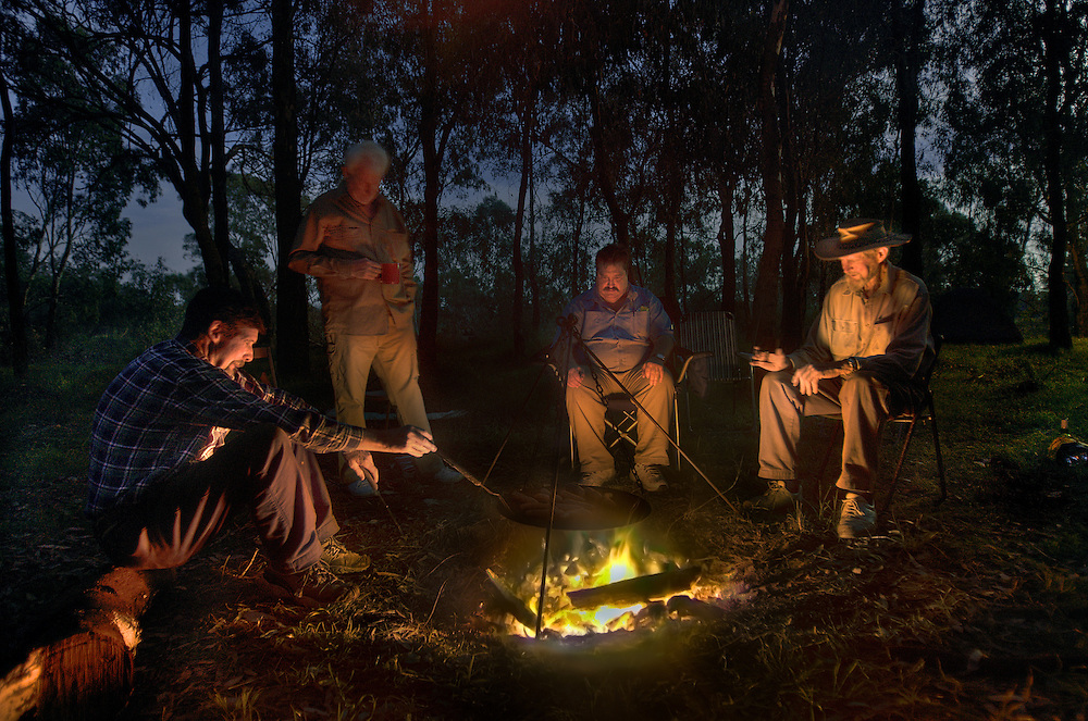 Left to right, Collin Wood, Ziggy Moeller, Robert Hodder and Lionel Swift around the moonlit camp fire. Opening of duck hunting season on the Murray Rive near Howlong. Pic By Craig Sillitoe CSZ/The Sunday Age. 19/3/2011 melbourne photographers, commercial photographers, industrial photographers, corporate photographer, architectural photographers, This photograph can be used for non commercial uses with attribution. Credit: Craig Sillitoe Photography / http://www.csillitoe.com<br />