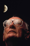 "Sir Arthur C. Clarke, composite. Colombo, Sri Lanka. Sir Arthur C. Clarke gazes at the moon. ""I can never look now at the Milky Way without wondering from which of those banked clouds of stars the emissaries are coming,"" one of Arthur C. Clarke's characters says in the short story ""The Sentinel"" (1948), which was the basis for his book 2001 - A Space Odyssey. MODEL RELEASED"