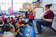 Thyler Dinh, center, reacts to a story read by teacher Wendy Lundeen in the transitional kindergarten class at Rose Elementary School in Milpitas, California, on April 5, 2013. (Stan Olszewski/SOSKIphoto)