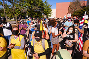 28 JULY 2020 - DES MOINES, IOWA: Supporters of Black Lives Matter wait for a BLM march to start in Des Moines. About 150 supporters of Black Lives Matter marched from downtown to Des Moines to the Governor's Mansion. They were demanding that Iowa Governor Kim Reynolds restore the voting rights for felons who have completed their sentence. In June, Reynolds met with representatives of Black Lives Matter and promised to sign an executive order to restore voting rights, but she hasn't said anything more about it in six weeks. Iowa is now the only state in the US that permanently strips felons of their voting rights. That means 60,000 people in Iowa can't vote.     PHOTO BY JACK KURTZ