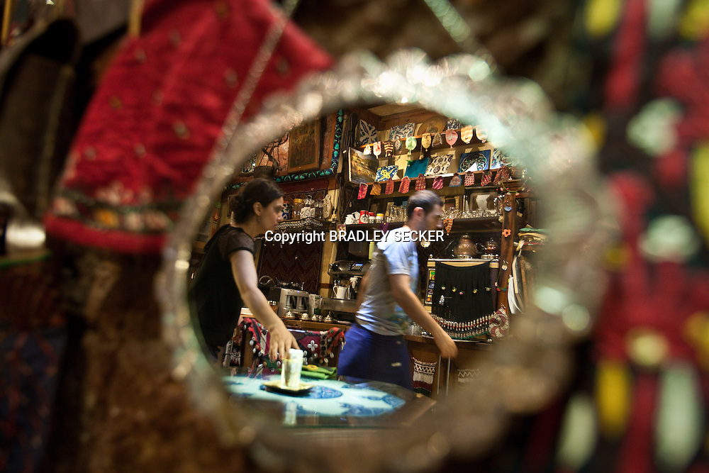 ISTANBUL, TURKEY, JUNE 2012: Waiters serve customers in Nebil Basmaci's carpet shop turn cafe in the heart of the Grand Bazaar. (Photo by Bradley Secker for the Washington Post)
