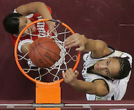 Aldine Nimitz's Brittney Griner (right) dunks over Macarthur's Danielle Whitmore during their matchup January 9, 2009 at the Campbell Center in Houston, Texas. The highly recruited, YouTube sensation, 6-8 Griner went on to play for Baylor University.