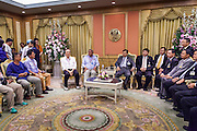 12 MAY 2014 - BANGKOK, THAILAND:  SUTHEP THAUGSUBAN (center left, blue shirt) and his supporters meets with SURACHAI LIANGBOONLERTCHAI (center right), the Speaker of the Thai Senate, and other Senators, in a meeting room in the Parliament building in Bangkok. Several thousand protestors with the People's Democratic Reform Committee (PDRC) blocked access to the Thai Parliament building in Bangkok as a part of their continuing anti-government protests. The Parliament is not currently in session and was dissolved by former Prime Minister Yingluck Shinawatra but the Senate is in session. The protestors are demanding that the Senate dissolve the current Pheu Thai caretaker government and appoint a new Prime Minister and cabinet. Members of the Senate leadership met with Suthep Thaugsuban Monday to discuss the impasse.  PHOTO BY JACK KURTZ