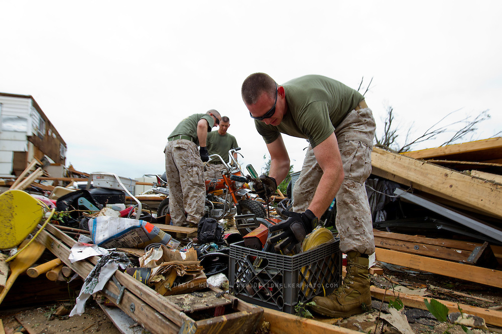 May 24, 2011- Marines sort through debris to help a resident of Joplin, Missouri after a Tornado came through the town on Sunday, May 22, 2011. Credit: David Welker / TurfImages.com