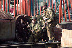 Reenactors portraying British paratroops of the 6th airborne division take part in a battle reenactment at Elsecar Heritage centre during the Elsecar 1940s Weekend <br />