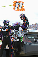 May 5, 2013; Talladega, AL, USA; NASCAR Sprint Cup Series driver Denny Hamlin (11) gets out of his car during the first caution at the Aaron's 499 at Talladega Superspeedway. Mandatory Credit: Randy Sartin-USA TODAY Sports