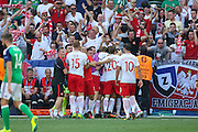 Poland players celebrate Poland Arkadiusz Milik opening goal 1-0 during the Euro 2016 match between Poland and Northern Ireland at the Stade de Nice, Nice, France on 12 June 2016. Photo by Phil Duncan.
