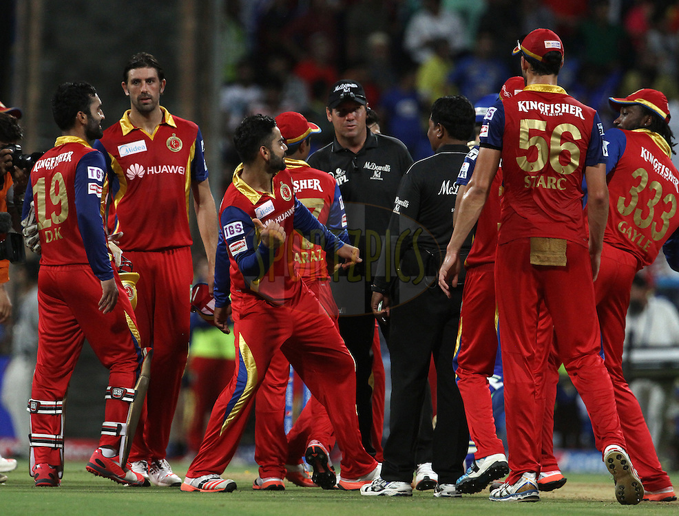Royal Challengers Bangalore players celebrate after winning the match 46 of the Pepsi IPL 2015 (Indian Premier League) between The Mumbai Indians and The Royal Challengers Bangalore held at the Wankhede Stadium in Mumbai, India on the 10th May 2015.<br /> <br /> Photo by:  Vipin Pawar / SPORTZPICS / IPL