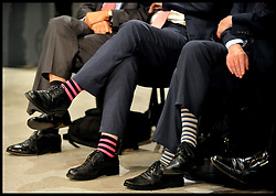 Lib Dem members with funny coloured socks listen to the Deputy Prime Minister Nick Clegg delivers his keynote speech at the end of the Liberal Democrats Conference in Brighton, Wednesday September 26, 2012 Photo Andrew Parsons / i-Images..