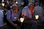 Lourdes France elderly people waiting during holy mass after candle parade at the basilica of the immaculate conception Notre Dame