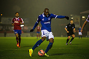 Nigel Atangana shots during the The FA Cup match between Aldershot Town and Portsmouth at the EBB Stadium, Aldershot, England on 19 November 2014.