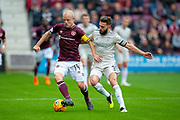Steven Naismith (#14) of Heart of Midlothian and Graeme Shinnie (#3) of Aberdeen FC during the Ladbrokes Scottish Premiership match between Heart of Midlothian and Aberdeen at Tynecastle Stadium, Edinburgh, Scotland on 20 October 2018.