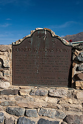 BURNED WAGONS POINT..Near this monument, the Jayhawker group of Death Valley Forty-Niners, gold seekers from Middle West, who entered Death Valley in 1849 seeking short route to the mines of central California, burned their wagons, dried the meat of some oxen and, with surviving animals, struggled westward on foot...State Registered Landmark No.441..Marker placed by California Centennials Commission. Base furnished by Death Valley '49ers, Inc...Dedicated December 3rd, 1949