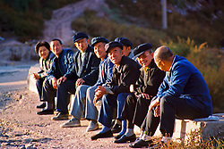 China, Datong, 2008. In a scene repeated the world over, retirees and friends take time to enjoy the sunshine on a Datong hillside.