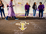 21 APRIL 2017 - CHANHASSEN, MN: Prince fans line the pedestrian tunnel in front of Paisley Park, his former home and recording studio. The tunnel has become a memorial to Prince, people have drawn graffiti in the tunnel honoring him and they leave memorials in the tunnel. The superstar died from an accidental overdose of the opioid fentanyl on April 21, 2016. Friday was the first anniversary of his death. Crowds of people gathered at Paisley Park, which is now a museum, to honor the Minnesota born musician.     PHOTO BY JACK KURTZ