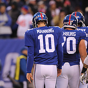 New York Giants quarterback Eli Manning and his team mates leave the field after failing to score on a fourth down attempt near the goal line during the New York Giants V San Francisco 49ers, NFL American Football match at MetLife Stadium, East Rutherford, NJ, USA. 16th November 2014. Photo Tim Clayton
