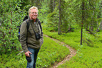 Frans Schepers in the taiga boreal forest along the King's Trail hiking trail, Padjelanta National Park, Kvikkjokk in the Laponia UNESCO World Heritage Site, Greater Laponia rewilding area, Lapland, Norrbotten, Sweden