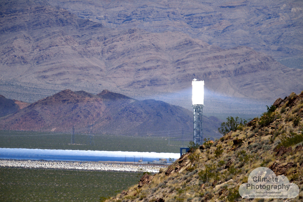 #SignOfClimateProgress Climate change requires some creative thinking about how to generate reliable power to the electricity grid.  The Ivanpah Solar Power Facility, located along the California/Nevada border along Interstate 15 near border-town Primm, NV, is a hybrid natural gas and solar collector steam-generating station.  Natural gas is used to pre-heat the station in the mornings.  The mirrors concentrate sunlight focused onto a tower holding boilers that heat water into steam, which turns turbines that generate electricity.  The basic concept of the power generation itself is very similar to any other turbine-based power generating system, as used in coal, natural gas, biofuel, nuclear, or hydroelectric generating stations.  The novelty of the Ivanpah system is that it uses sunlight as its fuel that it has to concentrate on-site.  <br />
