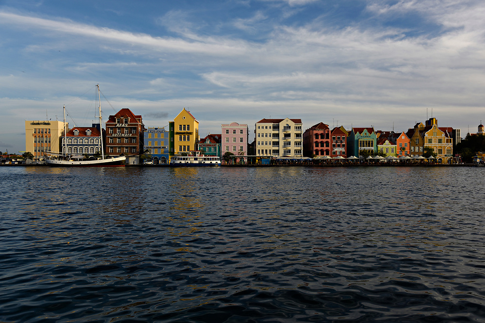 WILLEMSTAD, CURACAO - DECEMBER 12, 2014:  The instantly recognizable Curacao cityscape with its uniquely Dutch architecture facing Willemstad Harbor is seen across the Santa Anna Bay. (photo by Melissa Lyttle)