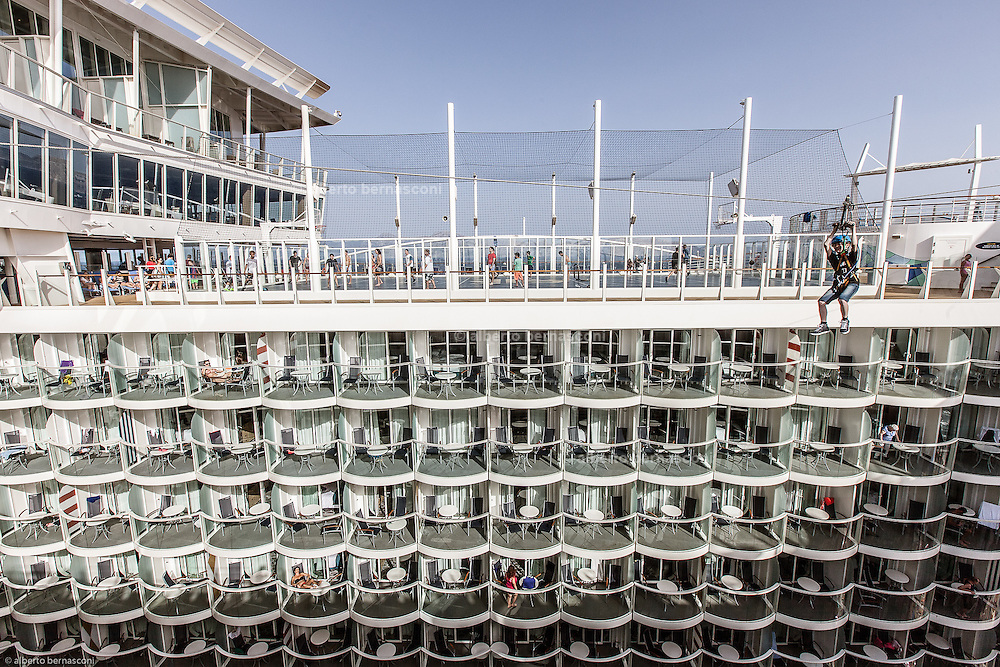 Royal Caribbean, Harmony of the Seas, zip lines take guests on an exhilarating ride across an open-air atrium suspended nine decks high above Boardwalk – a distance of more than 82 feet (25 meters).
