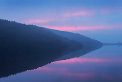 © Licensed to London News Pictures. 09/01/2016. Lindley Wood UK. Picture shows tree's reflecting in the calm water of Lindley Wood Reservoir at sunrise his morning. Photo credit: Andrew McCaren/LNP