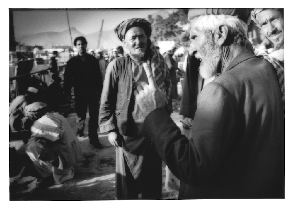 An argument in a market on a bridge over the Kabul River, Afghanistan.