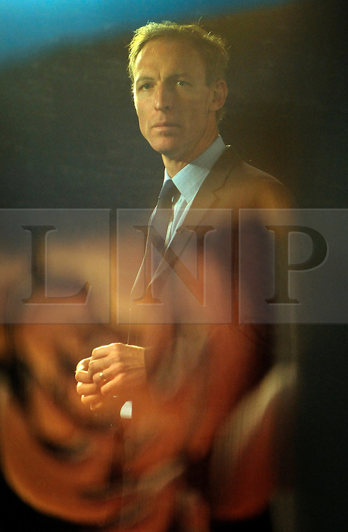 © Licensed to London News Pictures. 27/09/2011. LONDON, UK. Jim Murphy pictured through a TV studio window reflecting the labour rosette. The Labour Party Conference in Liverpool today (27/09/11). Photo credit:  Stephen Simpson/LNP