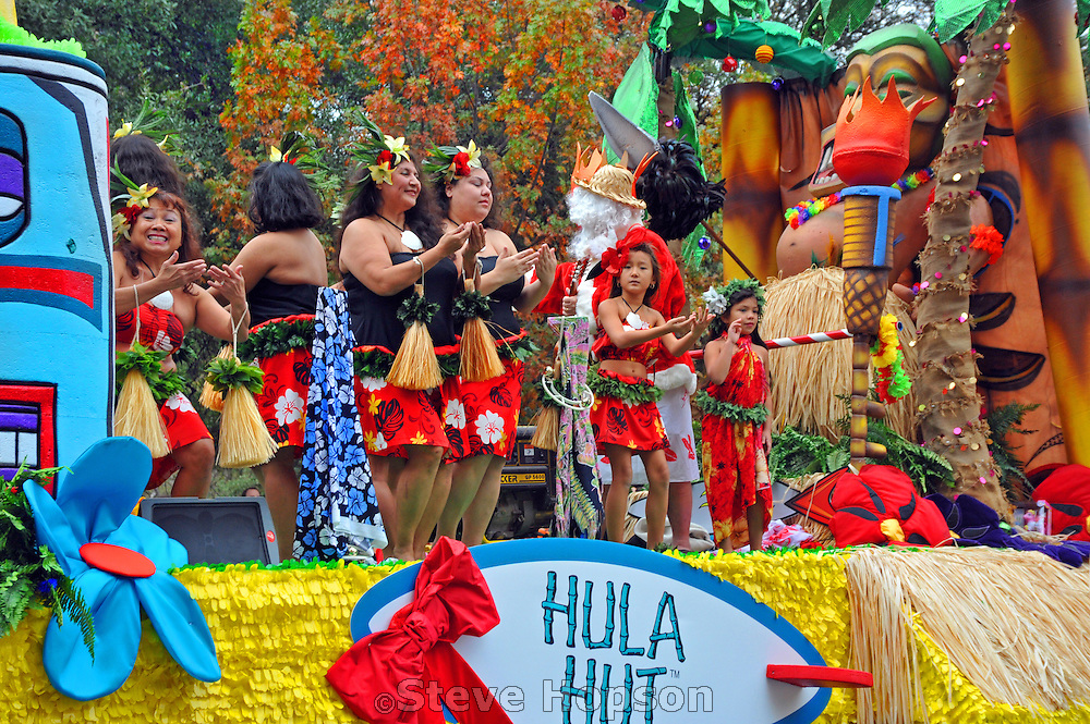 Hula Halau Ohana Elikapeka performing on the Hula Hut float at the 20th Annual Chuy's Children Giving to Children Parade, Austin, Texas, November 29, 2008. Chuy's is a Tex Mex restaurant in Austin.  The Children Giving to Children Parade features gifts given by the viewers to Operation Blue Santa.