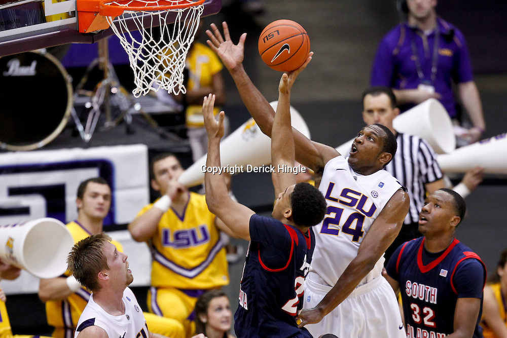 November 23, 2011; Baton Rouge, LA; South Alabama Jaguars center Augustine Rubit (21) has his shot blocked by LSU Tigers forward Storm Warren (24) during the second half of a game at the Pete Maravich Assembly Center. South Alabama defeated LSU in overtime 79-75. Mandatory Credit: Derick E. Hingle-US PRESSWIRE