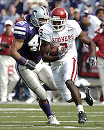 Oklahoma's Mark Clayton (9) rushes up field against Kansas State at KSU Stadium in Manhattan, Kansas on Oct. 16, 2004.