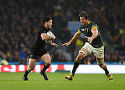 New Zealand wing Nehe Milner-Skudder tries to evade a tackle from South Africa lock Eben Etzebeth during the Rugby World Cup Semi-Final match between South Africa and New Zealand at Twickenham, Richmond, United Kingdom on 24 October 2015. Photo by David Charbit.