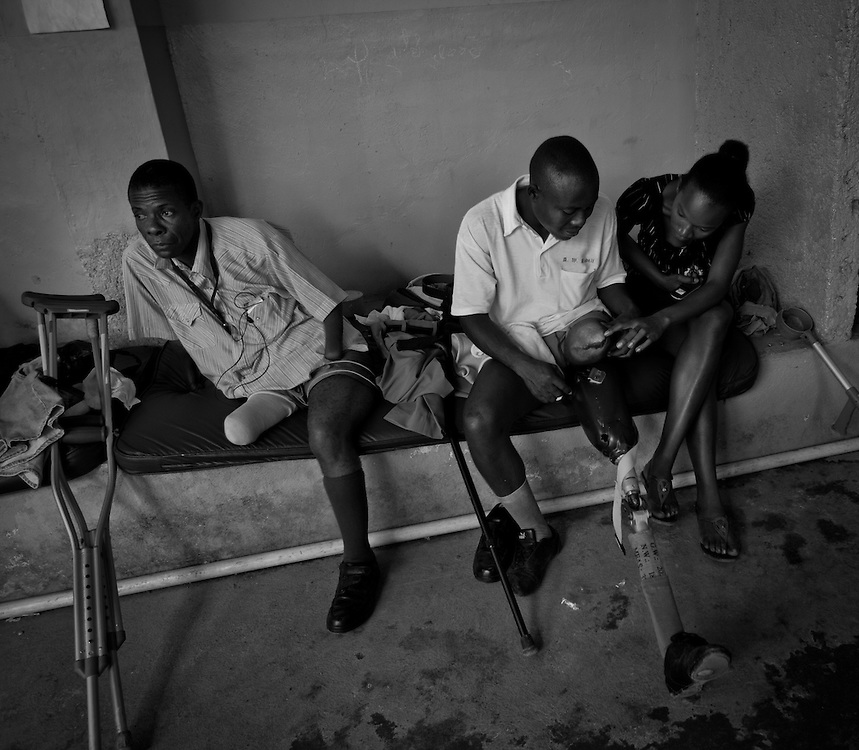Patients wait for their physical therapy to begin at Healing Hands Haiti Clinic. <br /> <br /> Healing Hands Haiti (HHH) in Port Au Prince has been established for 12 years since 1999. Currently, HHH is constructing a new facility in Port Au Prince because their old clinic was destroyed from the earthquake.   HHH provides physical therapy, counseling, prosthetics, and support for free or very little cost to Haitians.  Their funding comes from private donations and organizations such as Handicap International, Mission Europeene Aide Humanitarian, International Committee of the Red Cross (ICRC), American Red Cross, Newman's Own, Direct Relief International (DRI), SOROS Open Society Foundation, and USAID which pays for employees, doctors, supplies, and facilities.  The motto of HHH is &quot;to serve the people of Haiti is to enable them to help themselves.&quot;   Thus, most of their employees are Haitians with very few foreign expats. Furthermore, HHH recruits and teaches young Haitian students prosthetic and orthotic skills and physical therapy in a specialized program that will enable them to earn a degree approved by World Health Organization.