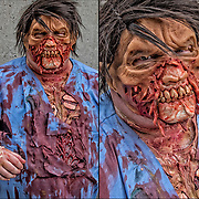 Cosplayer in his Zombie  costume at the New York Comic Con.<br /> <br /> The New York Comic Con convention, is a  celebration of comic books, graphic <br /> novels, sci-fi and video games, toys, movies and television.  <br /> <br /> More than 200,000 people attended the event dressed up as their favorite <br /> superhero to celebrate comic books, sci-fi and video games.