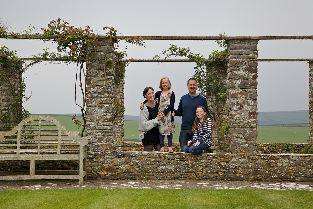 The Elliott family in the rose arbour at Pickwell Manor. From left to right: Tracey Elliott, Millie-grace Elliott (8), Richard Eliott, Molly Elliott (10). Pickwell Manor, Georgeham, North Devon, UK.<br /> CREDIT: Vanessa Berberian for The Wall Street Journal<br /> HOUSESHARE