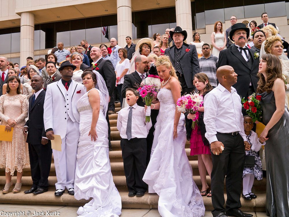 14 FEBRUARY 2012 - PHOENIX, AZ:    Couples gather on the steps of the Arizona Supreme Court for their mass wedding ceremony Tuesday. Ninetysix couples got married in a mass ceremony on the steps of the Arizona Supreme Court to mark the Valentine's Day holiday. The wedding was also an occasion to mark Arizona's centennial of statehood.   PHOTO BY JACK KURTZ