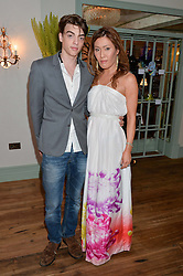 SASCHA BAILEY and his fiance MIMI NISHIKAWA at the 50th anniversary party for Daphne's restaurant, 112 Draycott Avenue, London held on 24th June 2014.