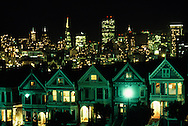 The Painted Ladies, Victorian houses facing Alamo Square in the Western Addition, downtown area behind, San Francisco, California