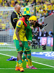 Norwich City Manager, Alex Neil is almost dropped from the shoulders of Norwich City's Russell Martin - Photo mandatory by-line: Joe Meredith/JMP - Mobile: 07966 386802 - 25/05/2015 - SPORT - Football - London - Wembley Stadium - Middlesbrough v Norwich - Sky Bet Championship - Play-Off Final
