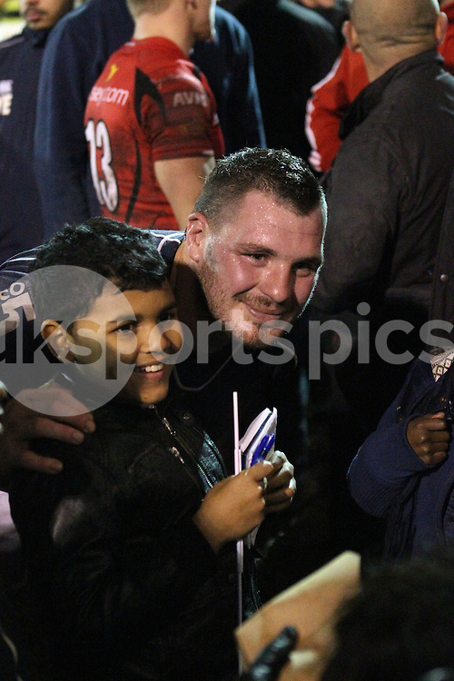 James Phillips poses for a picture with a young fan after the Green King IPA Championship match between London Scottish &amp; Jersey at Richmond, Greater London on Friday 14th November 2014<br /> <br /> Photo: Ken Sparks | UK Sports Pics Ltd<br /> London Scottish v Jersey, Green King IPA Championship,14th November 2014<br /> <br /> &copy; UK Sports Pics Ltd. FA Accredited. Football League Licence No:  FL14/15/P5700.Football Conference Licence No: PCONF 051/14 Tel +44(0)7968 045353. email ken@uksportspics.co.uk, 7 Leslie Park Road, East Croydon, Surrey CR0 6TN. Credit UK Sports Pics Ltd