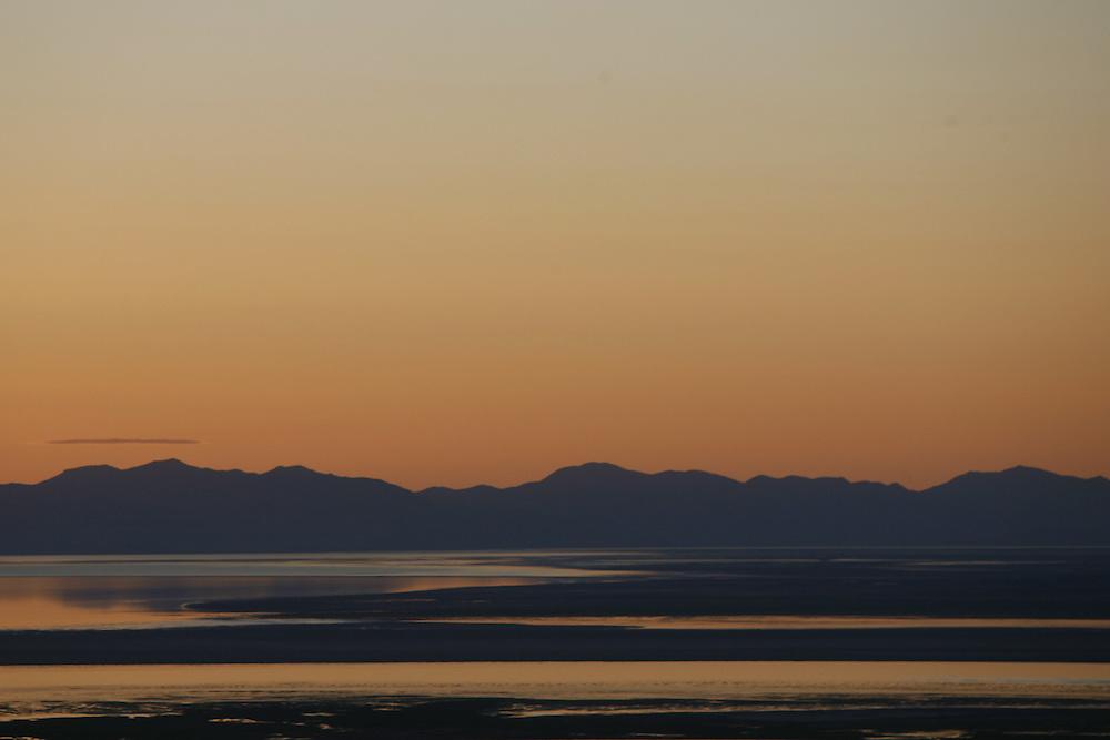 Sunset over Great Salt Lake from Bountiful, Utah foothills, June 16, 2006.  August Miller