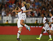 United States midfielder Lindsey Horan (9) jumps into  midfielder Samantha Mewis (3) arms celebrating a goal in an international friendly women's soccer match, Saturday, Aug. 3, 2019,  in Pasadena, Calif., The U.S. defeated Ireland 3-0. (Dylan Stewart/Image of Sport)