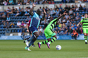 Forest Green Rovers Drissa Traoré(4) is tripped by Wycombe Wanderers Adebayo Akinfenwa(20) during the EFL Sky Bet League 2 match between Wycombe Wanderers and Forest Green Rovers at Adams Park, High Wycombe, England on 2 September 2017. Photo by Shane Healey.