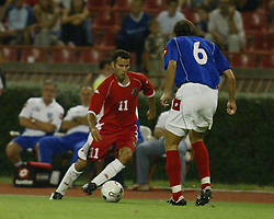 BELGRADE, SERBIA & MONTENEGRO - Wednesday, August 20, 2003: Wales' Ryan Giggs takes on Serbia & Montenegro's Goran Gavrancic during the UEFA European Championship qualifying match at the Red Star Stadium. (Pic by David Rawcliffe/Propaganda)